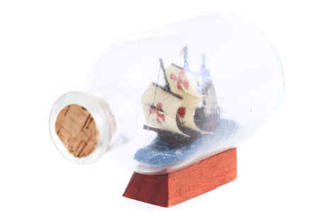 ship in glass bottle isolated on the white background Stock Photo