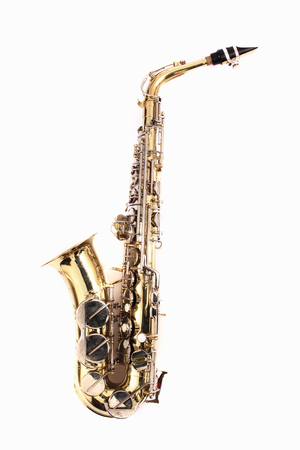 Very old saxophone on the white background
