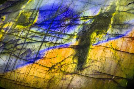 labradorite: labradorite natural golden and blue mineral background Stock Photo