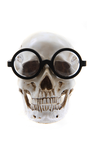 human skull with glasses isolated on the white background