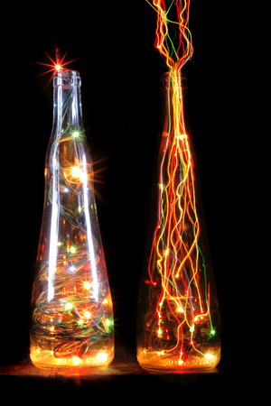 christmas bottle with color lights in the dark night