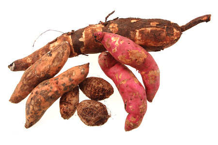 nice fresh manioc rootand sweet potatoses isolated on the white background Stock Photo