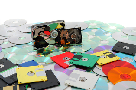 hard drive, floppy disc, and cd-rom as data background Stock Photo