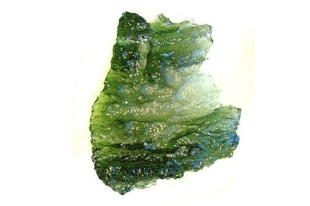 green moldavite mineral isolated on the white backgroud