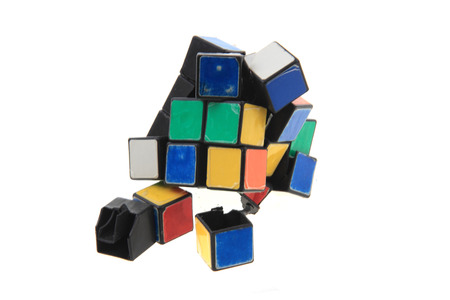 damaged rubic cube isolated on the white background Stockfoto