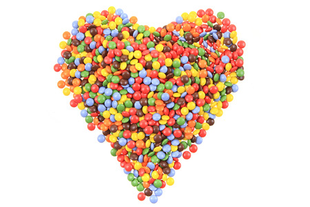 heart from color smarties isolated on the white background