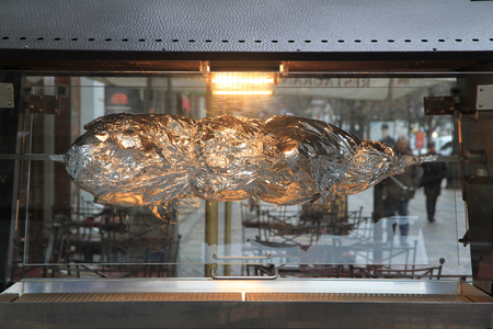 baked pig in kitchen foil as very nice food background