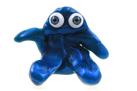plasticine figure with blue eyes isolated on the white background