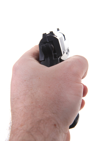 gun in human hand isolated on the white background Stok Fotoğraf