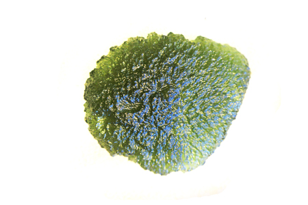 moldavite mineral from czech republic isolated on the white background