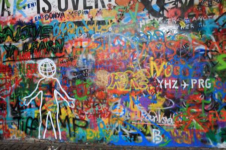 PRAGUE, CZECH REPUBLIC - AUGUST 23:The Lennon Wall since the 1980 filled with graffiti AUGUST 23, 2015 Prague, Czech Republic (city scene)