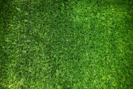 plastic green grass carpet texture as very nice background Foto de archivo - 119476474