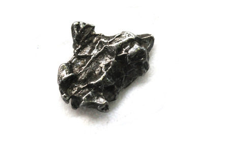 metal meteorite isolated on the white background