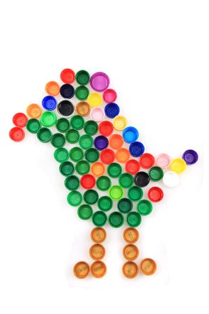 color bird from plastic caps isolated on the white background
