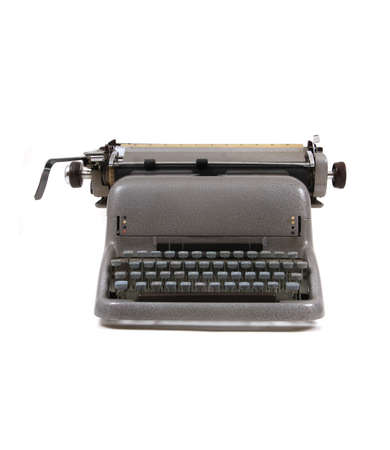 old typing machine isolated on the white background