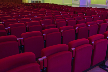 Red seats in cinema, theater, concert hall. Horizontally framed shot Stock Photo