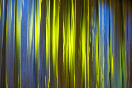 Texture background yellow curtain and shadow of light. Horizontally framed shot. Stock Photo