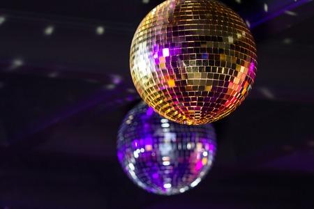 Disco balls on the ceiling. Horizontally framed shot.
