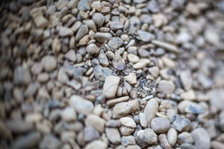 River or sea stone background. Set of all kinds of stones. Part of image is blurred. Horizontally framed shot.
