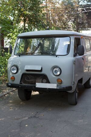 Old cargo van. Grey retro car. Vertically framed shot.