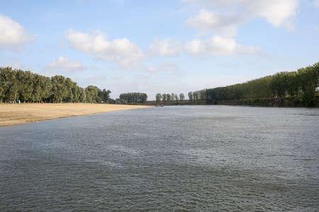 River landscape. Deserted sandy beach. Horizontally framed shot. 版權商用圖片