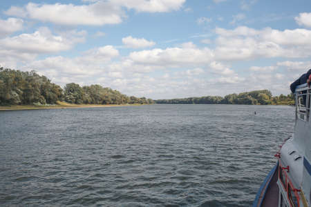 River view from a pleasure boat. Horizontally framed shot.