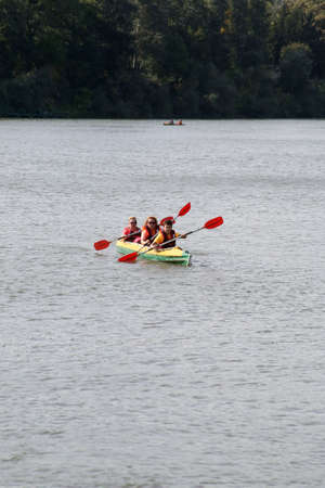 Chisinau, Republic of Moldova - October 04, 2020: Kayakers swim along the river. Vertically framed shot. 新聞圖片