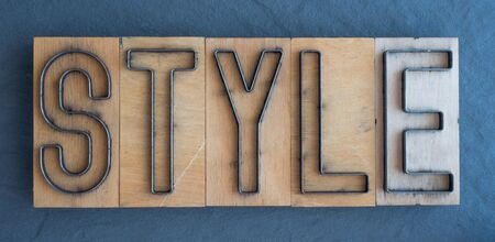 Old wood and steel number plate dies spell out the word STYLE