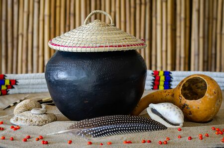 African beer, referred to as utshwala in Zulu, is brewed from mealie meal and drunk out of a clay drinking vessel called an ukhamba. A hollowed out calabash is used to scoop beer into the ukhamba.