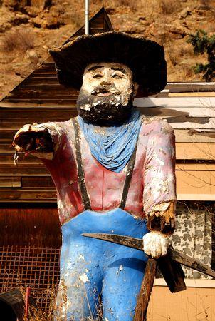 Worn miner statue