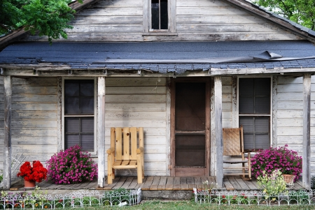 ramshackle: The front porch of a house that needs some  TLC.