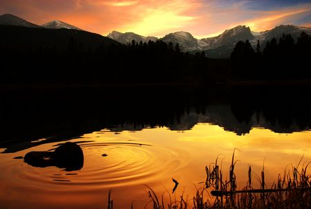 rockies: A calm lake in the rockies of Colorado at sunset. Stock Photo