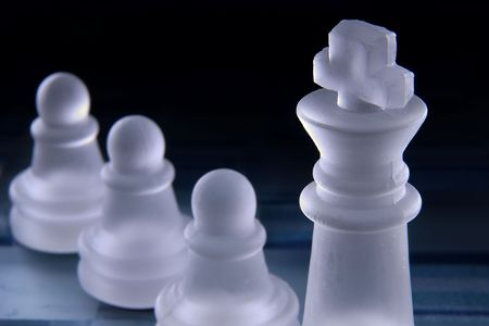 Chess pawns lined up at the King Stock Photo