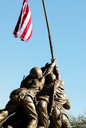 Marines holding up flag at Iwo Jima