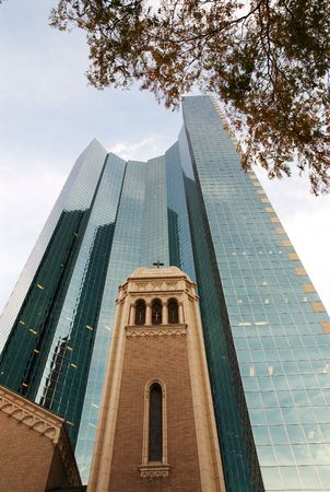 A church in Downtown Denver surrounded by a high-rise building. photo