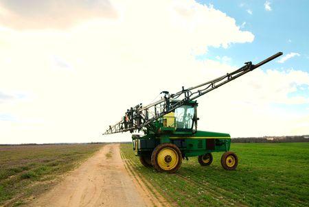 A tractor sprayer.