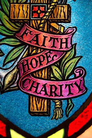 stain: Faith hope and charity Stock Photo