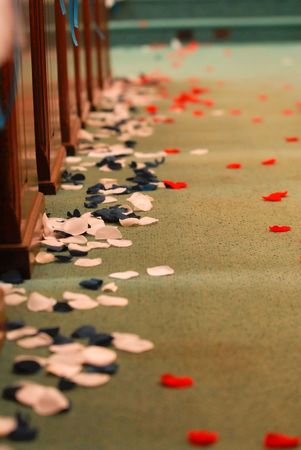 Rose pedals in an aisle of a church for a wedding. Reklamní fotografie