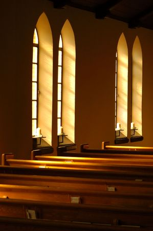 Church windows letting in morning light.