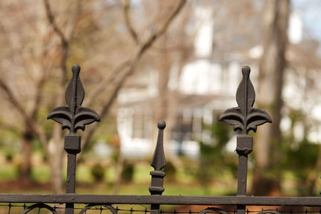 guard house: Cast iron gate fence in front of a house for security,