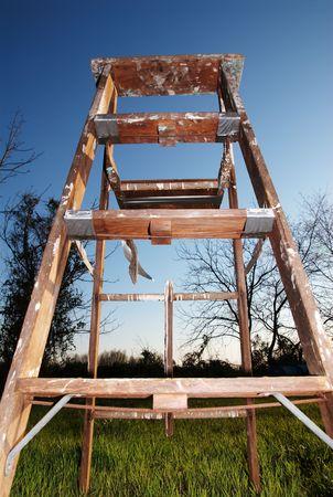 rungs: wooden step-ladder on blue sky