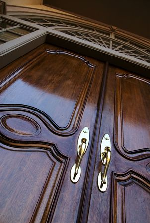 door knob: Two wooden front double doors entrance Stock Photo
