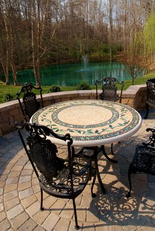 round chairs: Patio furniture with cast iron chairs Stock Photo