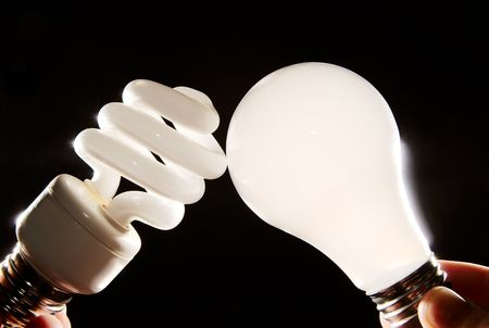 cfl: Cfl and incandescent lightbulbs on black Stock Photo