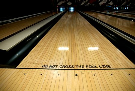 the foul line at a bowling alley in the lane.