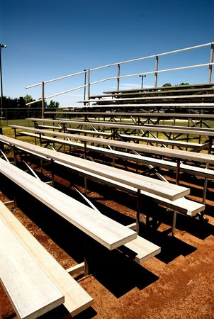viewers: empty bleachers with no people at a baseball game.
