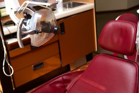disease patients: Dentist office examination chair with light Stock Photo