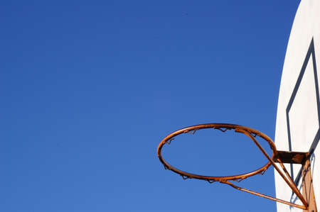 Red Basketball Hoop in the air photo