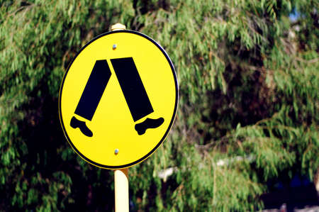 a yellow crossway sign