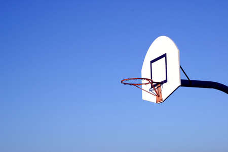 A view of basketball hoop under they sky
